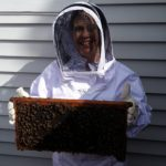 BZ Honey - One of our Introduction to Beekeeping students posing with a few of her friends.